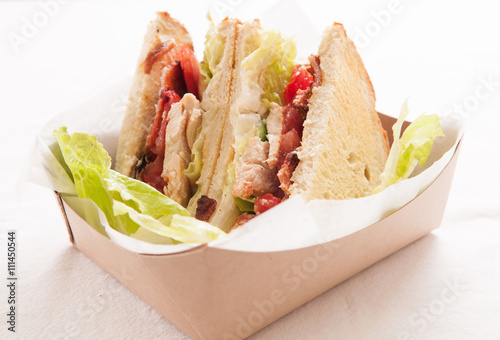 Fotografie, Obraz  artisinal clubhouse sandwich for take out