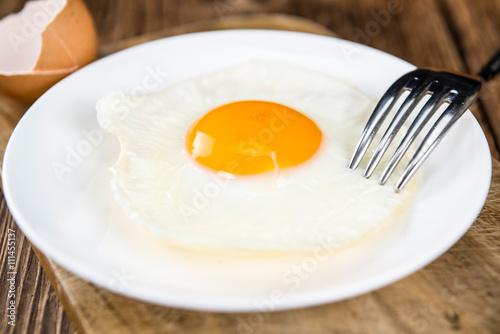 Deurstickers Gebakken Eieren Wooden table with Fried Eggs (selective focus)