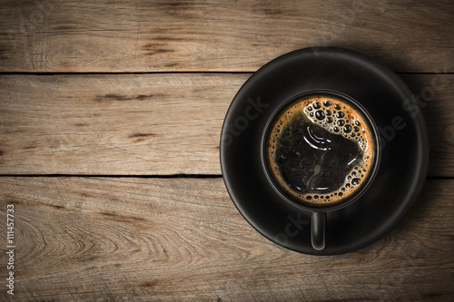 Wall Murals Cafe Coffee cup on a wood background., Flat lay.
