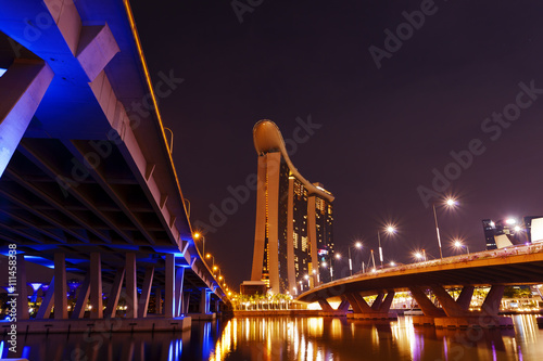 Obraz na plátne  Incredible bridges in Singapore at night down by the bay