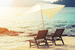 Beach chairs with parasol on the beach, soft focus, vintage tone