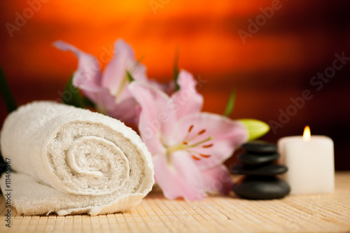 Fototapety, obrazy: Spa concept of lily flower, towels, sea salt, candle and crystal