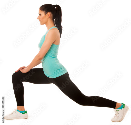 Canvas Print Beautiful young hispanic woman doing lunge exercise in fitness g