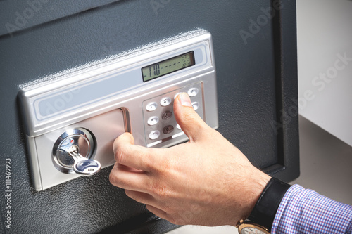 Fototapeta hand opened a safe, close up obraz