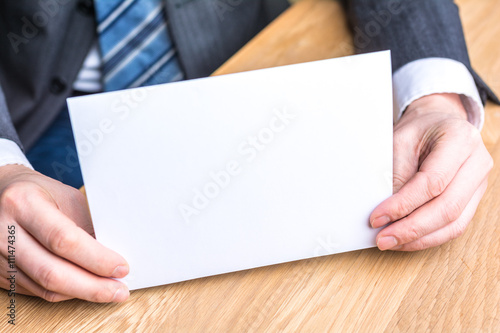 Fototapety, obrazy: hand of businessman and blank white paper