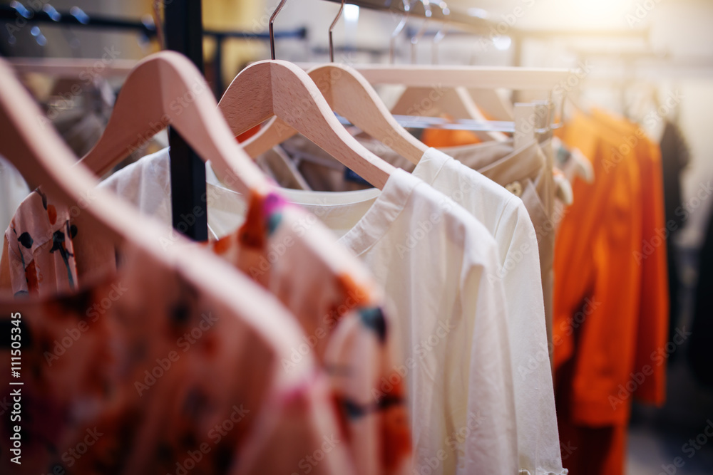 Fototapeta Clothing on hanger at the modern shop boutique