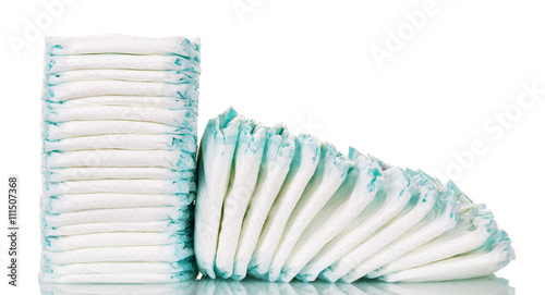 Fotografiet  Stacks  diapers for children isolated on white background.