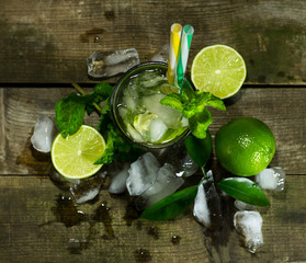 Mojito with ice on wooden background