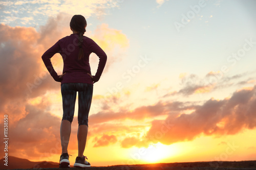 261d23fe72f Female sports person living healthy lifestyle. By Maridav. Active woman  looking ahead at sunset sky for life challenge. Runner athlete getting  ready for