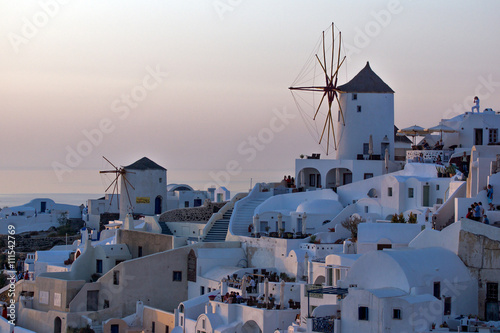 Poster Light pink Sunset in Town of Oia, Santorini, Tira Island, Cyclades