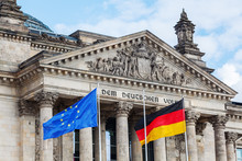 German Reichstag In Berlin, Germany, With National Flags