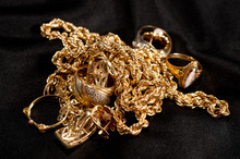 Scrap Gold Jewellery Including Chains, Bracelets And Rings On A Black Background