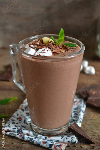 Foto op Plexiglas Chocolade chocolate smoothie with oats and marshmallow on a wooden backgro