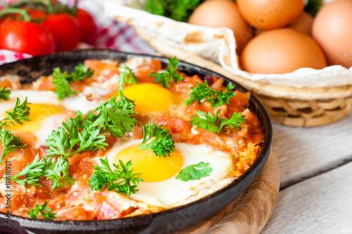 Deurstickers Gebakken Eieren fried eggs in tomato sauce, shakshuka