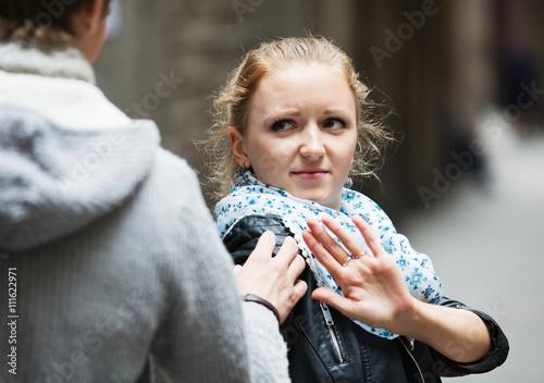 Fotografia Public harassment: man chasing  irritated girl