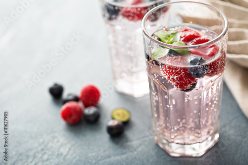 Sparkling water with raspberries and blueberries