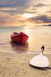 Kayak on the beach in sunset