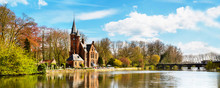 Minnewater Lake Panorama, Reflection Of Gothic Building And People In Cafe Near Castle De La Faille, Cloudy Blue Sky, Bruges, Belgium