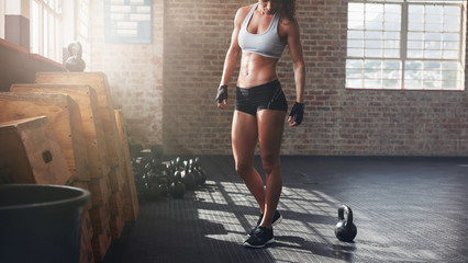 Muscular woman standing in ...