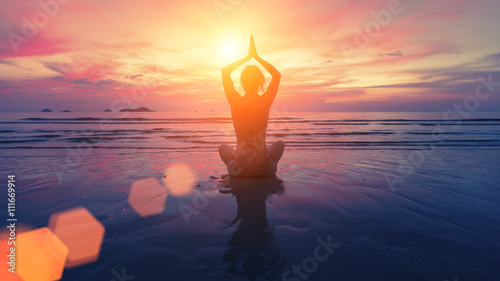 Obraz Woman yoga silhouette on the beach at amazing sunset. - fototapety do salonu
