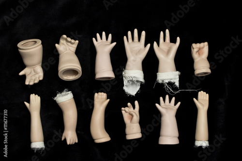 Photo Broken Doll Body Parts on Black Background