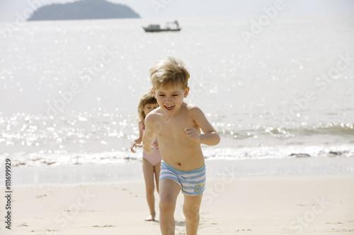 Plakat Two Scandinavian children playing on the beach, Brazil.