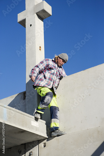 A building worker at a building site, Sweden.