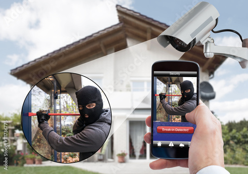 Person Hand Holding Mobile Phone Detecting Burglar