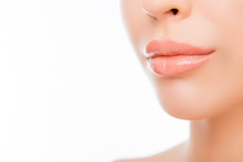 Close-up Woman's Lips With Natural Make Up On White Background