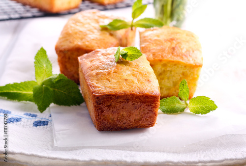 Fotografie, Obraz  Mini loaf cakes with mint decoration