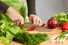 Woman Hands Chopping Vegetables