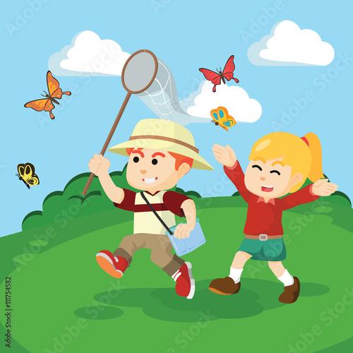 Foto op Canvas Magische wereld boy an girl catching butterflies togther