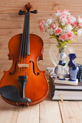 Fototapeta na wymiar Violin and romantic doll on wood background