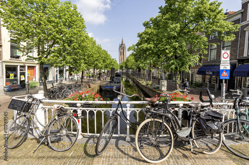 Canal in the center of delft with the classic bike