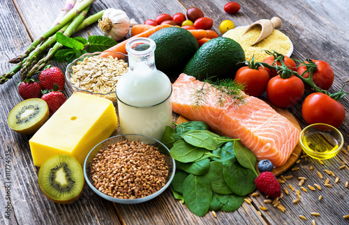 Tuinposter Eten Selection of healthy food on rustic wooden background