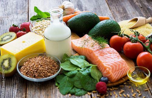 Poster Eten Selection of healthy food on rustic wooden background