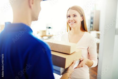 Fotografie, Obraz  Delivering a parcel