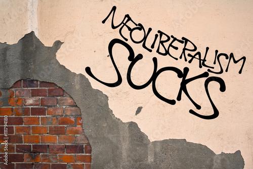 Foto op Aluminium Graffiti Handwritten graffiti Neoliberalism Sucks sprayed on wall, anarchist aesthetics. Appeal to fight against economy that declare fiscal austerity, deregulation, free trade, privatization