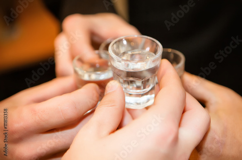 Man hand with glass of vodka , close up Tableau sur Toile