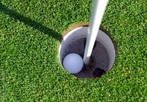 Fotografie, Tablou Golf ball and Flagstick of  Mancured grass of putting green