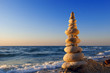 Concept of harmony and balance. Rock Zen at sunset. Balance and
