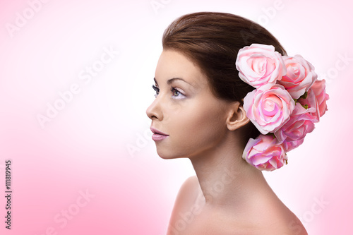 Beautiful young brunette woman with pink rose - fototapety na wymiar