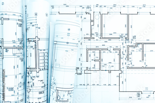 Blueprint rolls and technical drawings on architect work table buy blueprint rolls and technical drawings on architect work table malvernweather Gallery