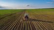 Leinwandbild Motiv Tractor cultivating field at spring