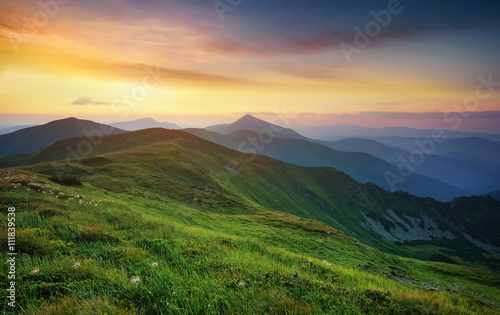 Obraz Mountain valley during sunrise. Natural summer landscape. - fototapety do salonu