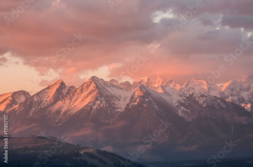 Foto auf Gartenposter Gebirge Cloudy Tatra mountains in the beautiful morning, covered with snow