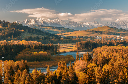 Foto auf AluDibond Gebirge Beautiful autumns panorama over Bialka river gorge and Spisz highland to snowy Tatra mountains, Poland