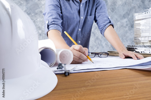 Architect or engineer working on blueprint, Construction and engineering concept. Engineering tools.