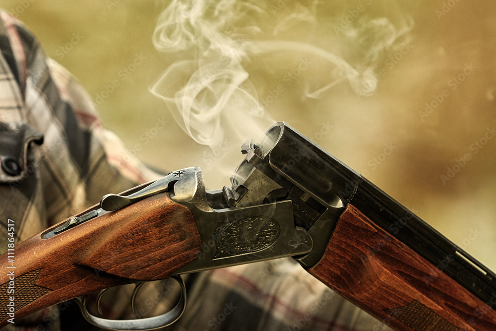 Fototapeta Hunting rifle after firing . Hunting in the forest