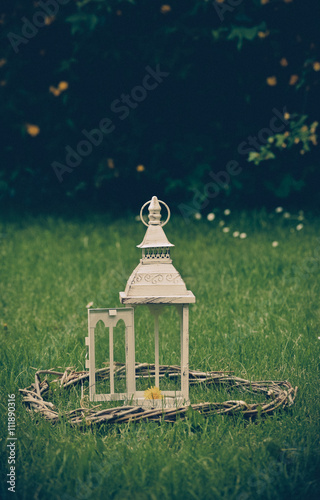 Photo  lantern on grass in vintage style